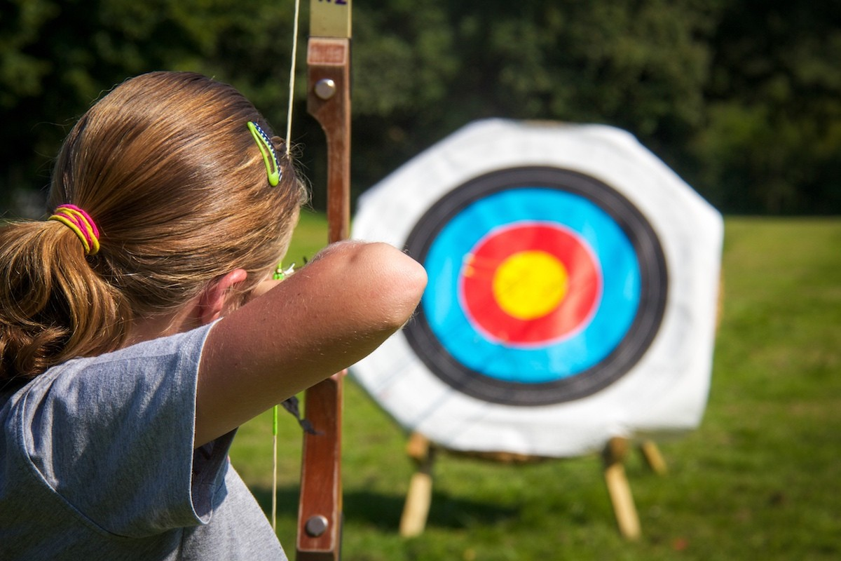 a girl pointing at a target